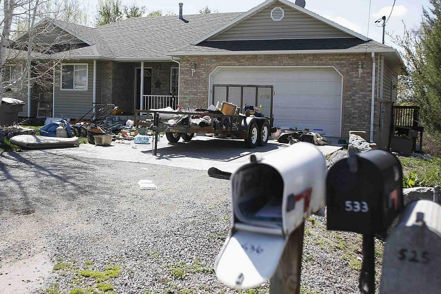 The bodies of the seven dead babies were found in cardboard boxes in the garage of this house (left) in Pleasant Grove, Utah. Megan Huntsman (below), the babies' mother, has admitted to killing six of them.