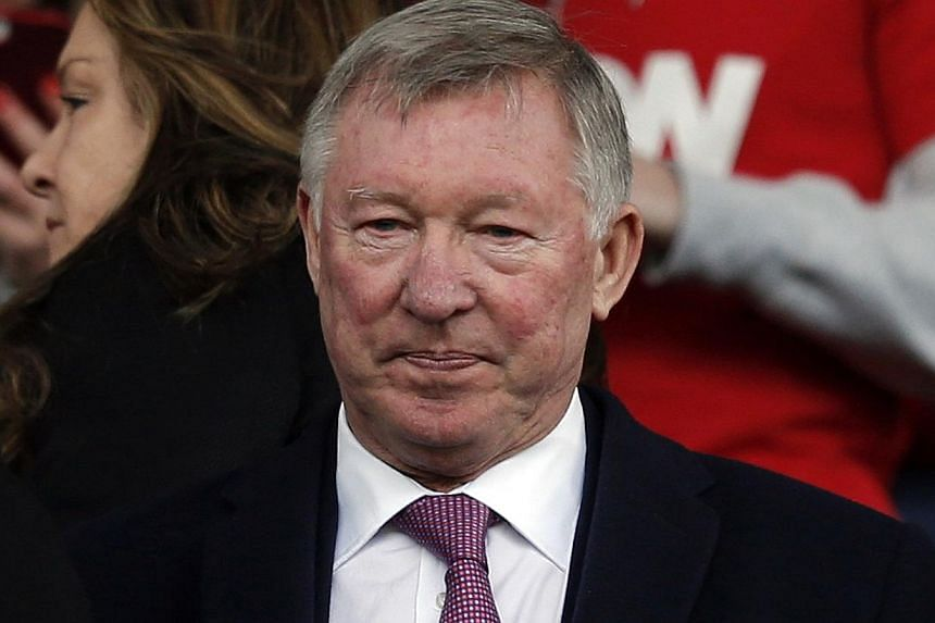 Former Manchester United manager Alex Ferguson takes his seat in the stands before their English Premier League soccer match against Liverpool at Old Trafford in Manchester, northern England, on March 16, 2014. -- FILE PHOTO: REUTERS