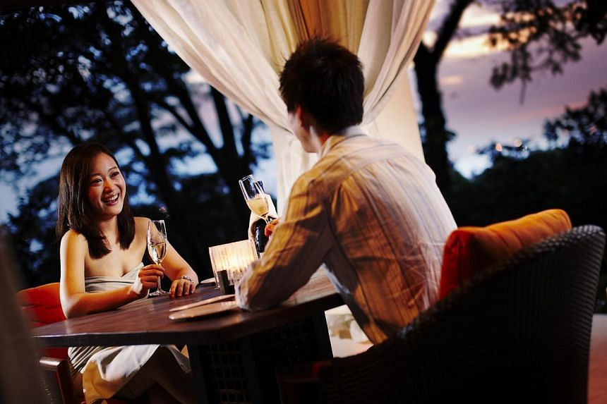 A couple having dinner at The Cliff restaurant at The Sentosa, a Beaufort Hotel. -- FILE PHOTO: THE SENTOSA, A BEAUFORT HOTEL
