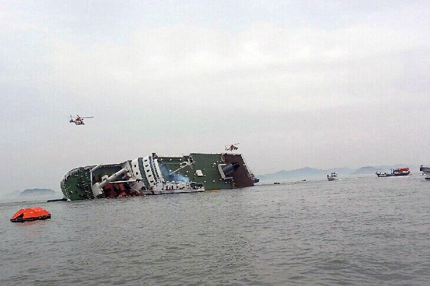 A South Korean passenger ship that has been sinking is seen at the sea off Jindo April 16, 2014. -- PHOTO: REUTERS