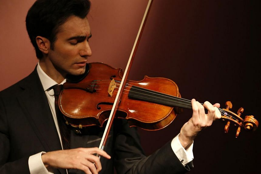 Violist David Aaron Carpenter plays the 'Macdonald' Viola by Antonio Stradivari, made in 1719, during a presentation at Sotheby's auction house in Paris on April 15, 2014. -- PHOTO: REUTERS