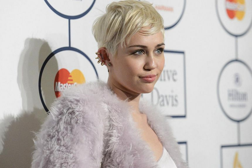 """Singer Miley Cyrus cancelled her Tuesday show in Kansas City, Missouri, after being hospitalised for a """"severe allergic reaction to antibiotics"""", the show venue said. -- FILE PHOTO: REUTERS"""
