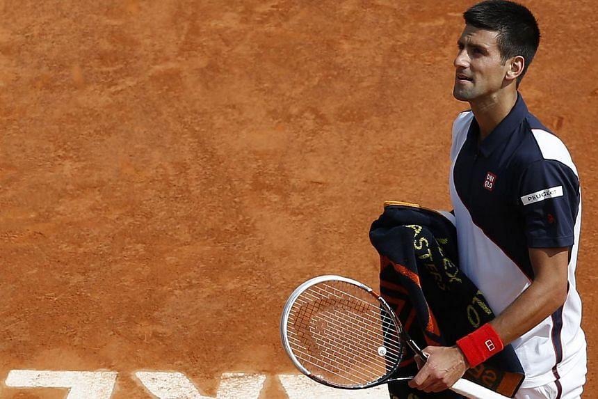 Serbia's Novak Djokovic (above) looks on during a Monte-Carlo ATP Masters Series Tournament tennis match against Spain's Albert Montanesin Monaco on April 15, 2014. -- PHOTO: AFP