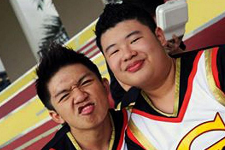It was a sad day for the cheerleading community here when Ngee Ann Polytechnic student Lai Qing Xiang (right), 18, died after he fell while performing a gymnastic manoeuvre in August last year.-- PHOTO:WANBAO READER