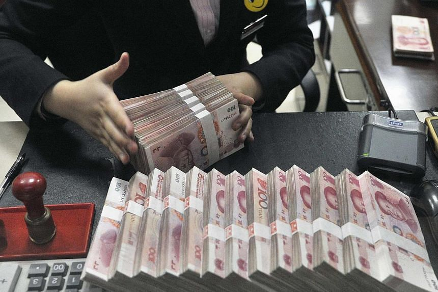 China said on Wednesday, April 16, 2014, that it will push forward with reform of its renminbi exchange rate mechanism after the United States criticised Beijing for keeping its currency weak. -- FILE PHOTO: REUTERS