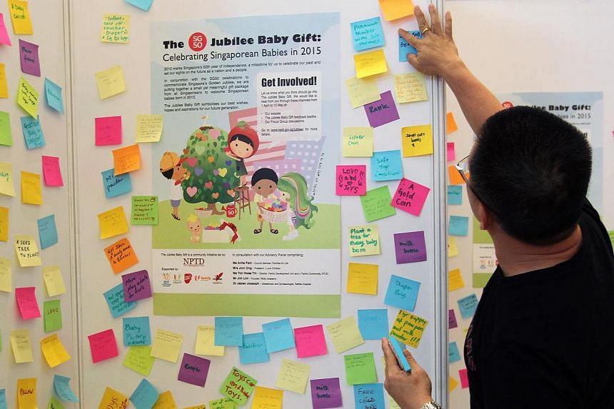 A member of the public puts up his suggestions for the Jubilee Baby Gift at VivoCity on Sunday, April 13, 2014. Fifteen items have been shortlisted for the Jubilee Baby Gift, which will be given out to all Singaporeans born next year - the country's