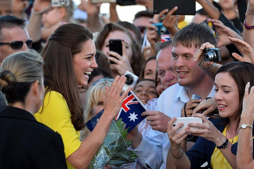 Catherine (second from left), the Duchess of Cambridge, meets with fans outside Sydney's iconic landmark Opera House, on April 16, 2014. -- PHOTO: AFP