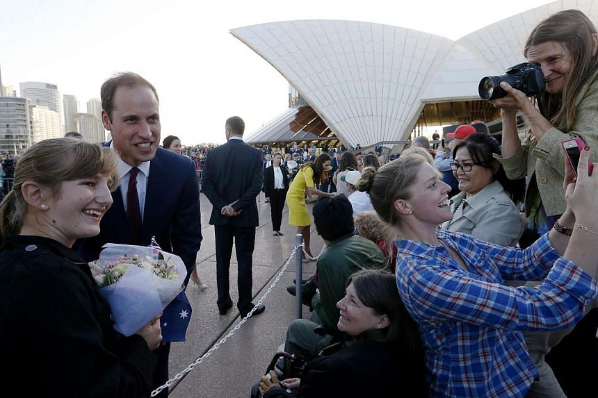 Britain's Prince William and his wife Catherine, the Duchess of Cambridge, in front of the Sydney Harbour Bridge during a reception at the Sydney Opera House, on April 16, 2014. -- PHOTO: REUTERS