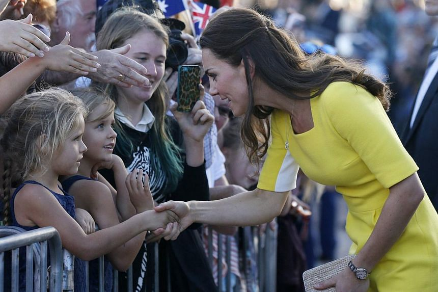 Catherine, Duchess of Cambridge, greets well-wishers following a reception with her husband, Britain's Prince William, at the Sydney Opera House, on April 16, 2014. -- PHOTO: REUTERS