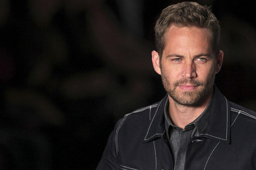 The brothers of actor Paul Walker (above) who died in November, will fill in for the late action star in order to complete scenes in the upcoming film Fast & Furious 7, according to a statement posted on the film's Facebook page. -- FILE PHOTO: R