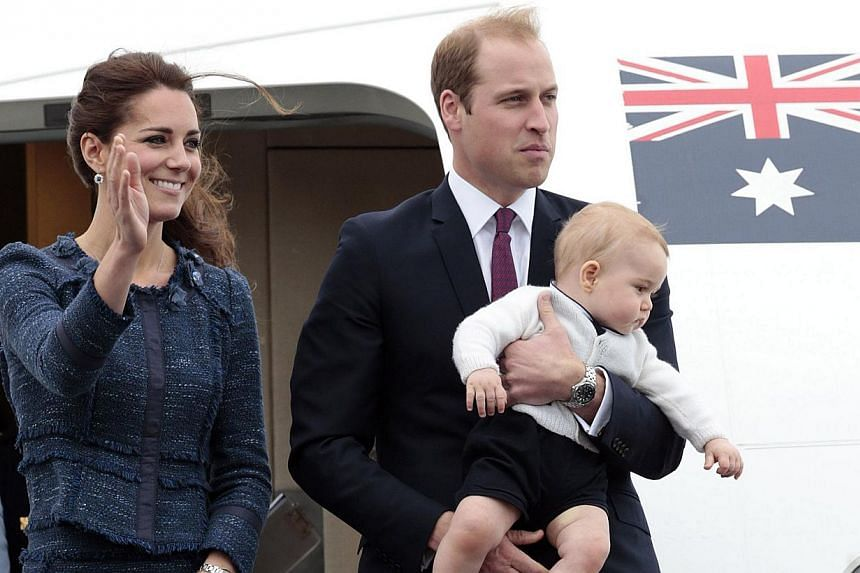 Catherine, the Duchess of Cambridge, waves beside her husband Britain's Prince William with their son Prince George as they depart Wellington on an Australian air force jet, on April 16, 2014. -- PHOTO: REUTERS