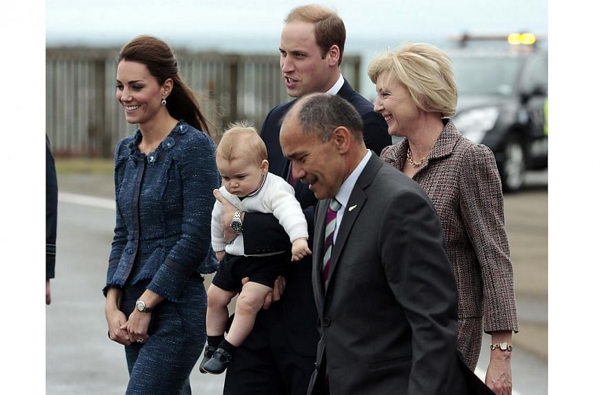 Britain's Prince William and his wife Catherine, the Duchess of Cambridge, with their son Prince George, walk with Governal General Sir Jerry Mateparae and Lady Janinie as they depart Wellington on an Australian Air Force jet on April 16, 2014. -- PH