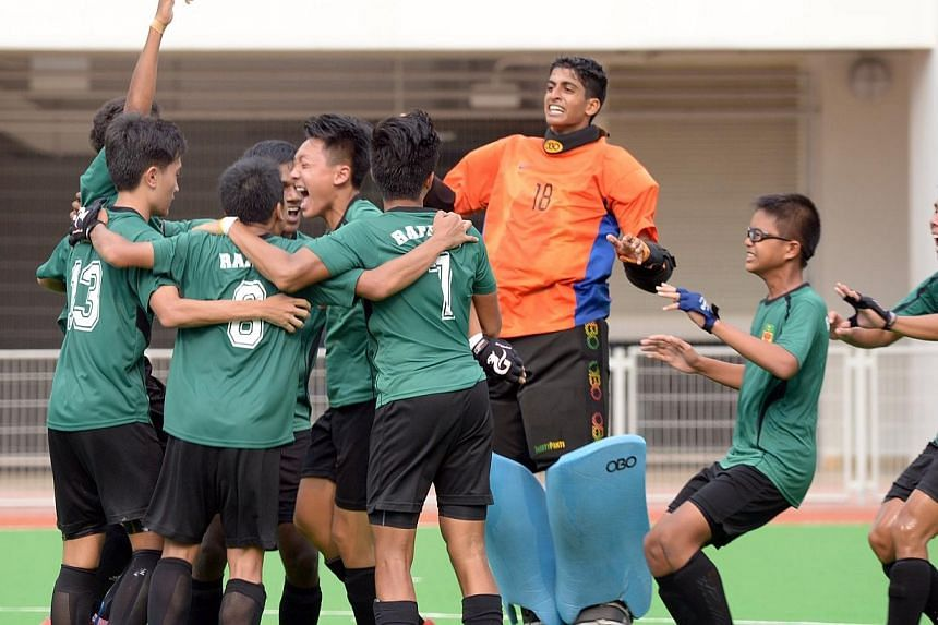 Raffles Institution players celebrate after beating Victoria School in theNational Schools 11-a-side hockey B division boys' finalat Sengkang Hockey Stadium on Wednesday, April 16, 2014. -- ST PHOTO: LIM SIN THAI