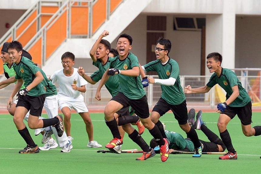 Raffles Institution players celebrate after winning the penalty shoot-out. -- ST PHOTO: LIM SIN THAI