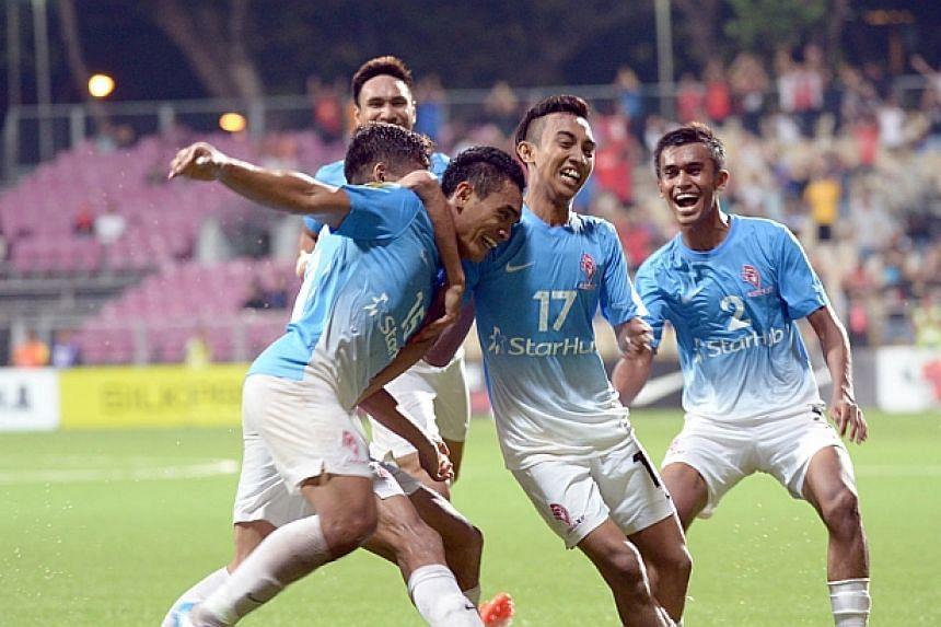 Sufian Anuar celebrates after scoring a hat-trick. -- ST PHOTO: DESMOND WEE