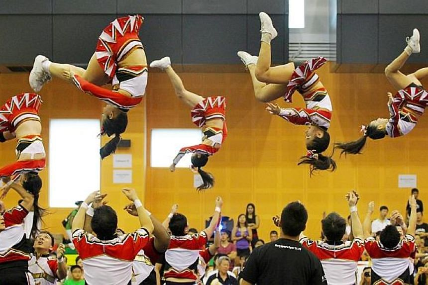 The Denvers during the National Cheerleading Championships at the Pasir Ris Sports and Recreation Centre Sports Hall on March 25, 2012.-- FILE PHOTO: THE NEW PAPER