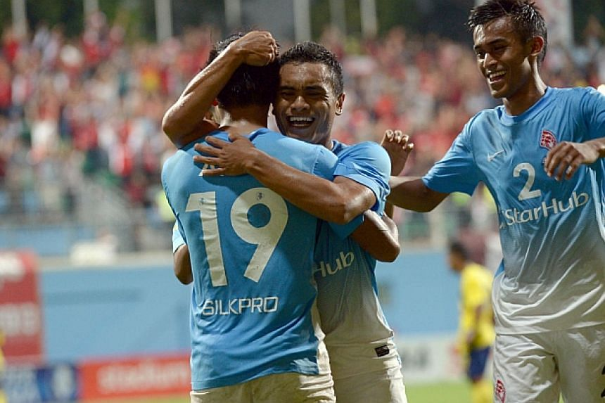 Sufian Anuar hugs teammate Khairul Amri after scoring. -- ST PHOTO: DESMOND WEE