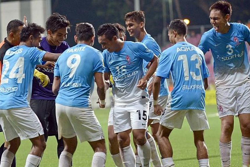 Sufian Anuar (centre, No. 15) celebrates with his teammates. His hat-trick gave the LionsXII a 4-1 win over Malaysian Super League leader Pahang on Tuesday, April 16, 2014. -- ST PHOTO: DESMOND WEE