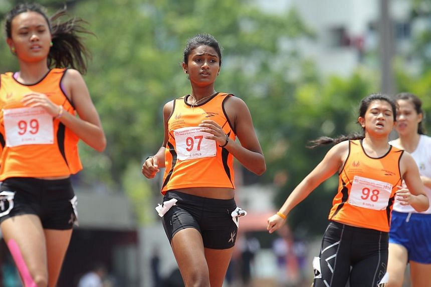 Nur Izlyn (left), Kugapriya (centre) and Anastasia Lim of the Singapore Sports School. They finished first, second and third respectively in the B Division 100m final.-- ST PHOTO:ONG WEE JIN