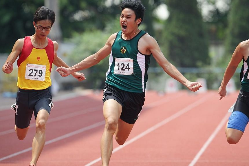 Chin Yew Chung (124) from Raffles Institution gestures after winning the A Division 100m event.-- ST PHOTO:ONG WEE JIN