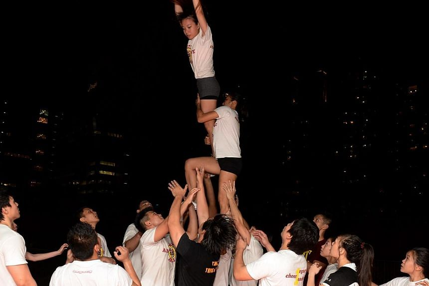 Cheerleading squad Legacy All-Stars during a training session at *Scape. -- ST FILE PHOTO: AZIZ HUSSIN