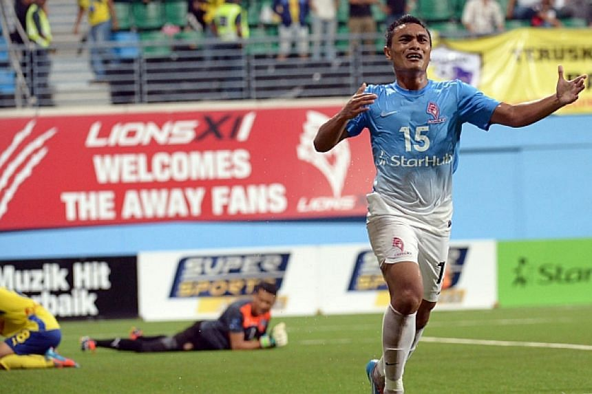 LionsXII's Sufian Anuar celebrates after scoring one of his goals against Pahang. -- ST PHOTO: DESMOND WEE