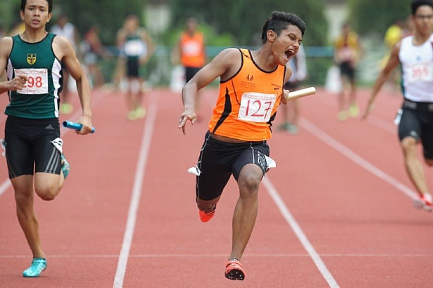 Muhammad Syazani B Abdul Wahid from the Singapore Sports school finishing first in the the B Boys 4x100metres relay.-- ST PHOTO:ONG WEE JIN