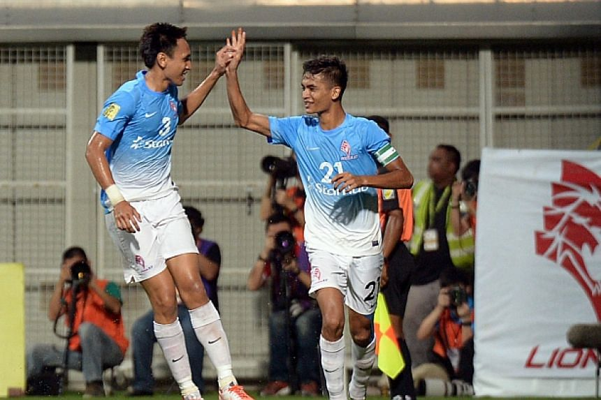 LionsXII's captain Safuwan Baharudin (right) celebrates with Afiq Yunos after scoring the equaliser against Pahang. -- ST PHOTO: DESMOND WEE