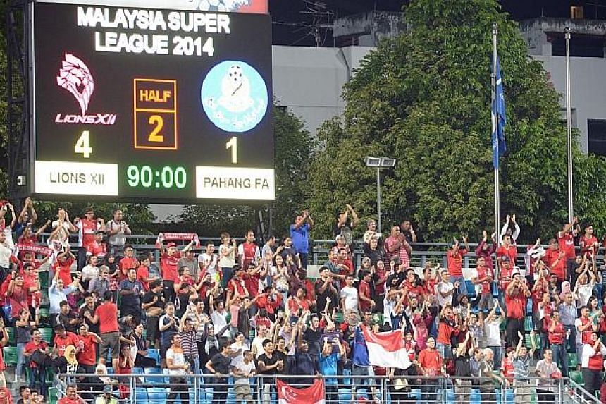 Fans celebrate asLionsXII beat MSL leaders Pahang 4-1 at Jalan Besar Stadium. -- ST PHOTO: DESMOND WEE