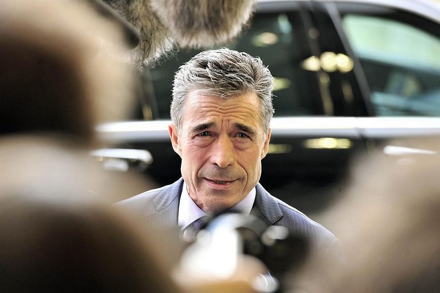 NATO Secretary General Anders Fogh Rasmussen speaks to journalists prior to a Ministers of Defence Council meeting on April 15, 2014, at the EU Headquarters at the Kirchberg Conference Center in Luxembourg. Military alliance Nato said on Wednesd