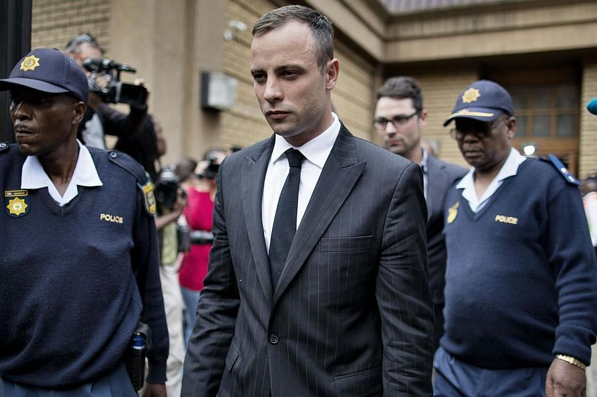 Oscas Pistorius (centre) leaves the North Gauteng High Court on Wednesday, April 16, 2014, in Pretoria. The prosecution on Wednesday derided a forensic expert hired by Paralympian Oscar Pistorius, accusing him of being unqualified to testify and