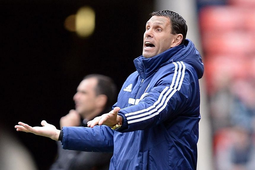 Sunderland's manager Gus Poyet during a match against Everton at the Stadium of Light on April 12, 2014. Poyet has dismissed speculation suggesting that he is poised to leave the relegation-threatened English side after telling reporters earlier this