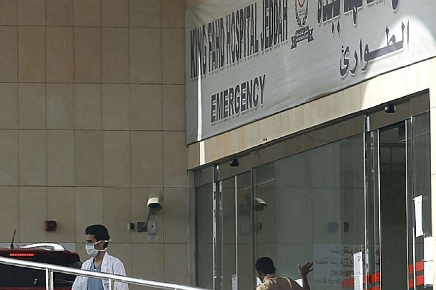 A Saudi medical staff and a security guard stand at the emergency department of Jeddah's King Fahd Hospital, which was closed by the authorities after two health workers were infected with the Middle East respiratory syndrome coronavirus (Mers).&nbsp