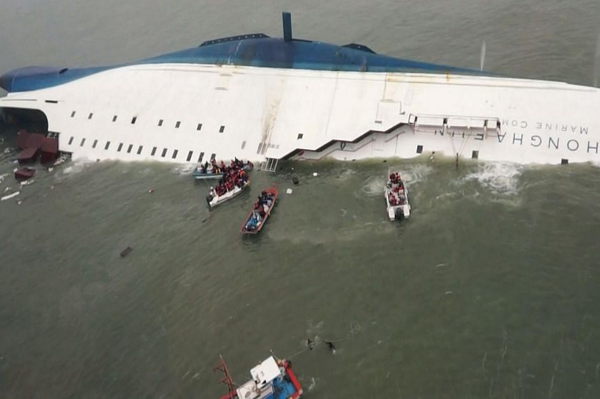 """South Korean ferry """"Sewol"""" is seen sinking in the sea off Jindo on Wednesday, April 16, 2014, in this picture provided by Korea Coast Guard and released by Yonhap.A massive operation is underway off the coast of Jindo Island in South Jeolla Pro"""