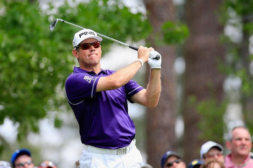 Lee Westwood of England watches his tee shot on the fourth tee during the final round of the 2014 Masters Tournament at Augusta National Golf Club on April 13, 2014, in Augusta, Georgia.Lee Westwood and Louis Oosthuizen head a trio of former Ma