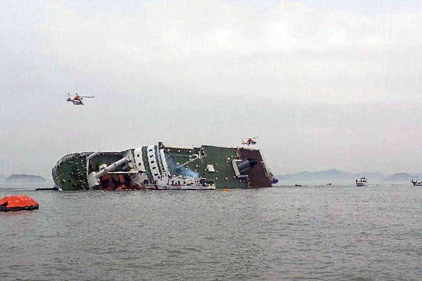 The South Korean passenger ship seen sinking in the sea off Jindo on April 16, 2014. -- PHOTO: REUTERS