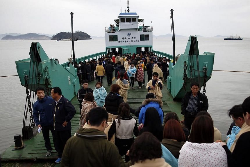 Family members of missing passengers who were on the South Korean ferry Sewol which sank in the sea off Jindo, board a ferry ship heading to the accident site, at a port where family members of missing passengers have gathered, in Jindo on April 17,
