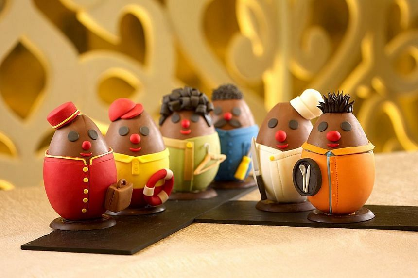 Chocolate Easter eggs in the iconic uniform of Shangri-La front line staff are created by executive pastry chef Herve Potus and his team to pay tribute to the hotel's staff during the Easter season. -- FILE PHOTO: SHANGRI LA HOTEL