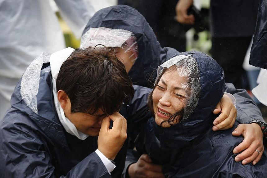 Crying family members of passengers missing on the overturned South Korean ferry Sewol at the port in Jindo on Thursday, April 17, 2014.The Chinese embassy in Seoul confirmed on Thursday that two Chinese citizens were on board a South Korean pa