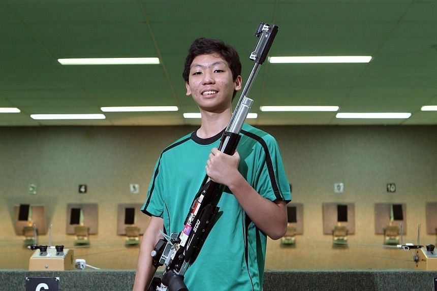 Sean Tay of Raffles Institution (RI),who broke the 10-year-old B Division boys' air rifle record with 594 points.RI emerged as the top school at the Schools National Shooting Championships on Thursday, April 17, 2014, with five titles in