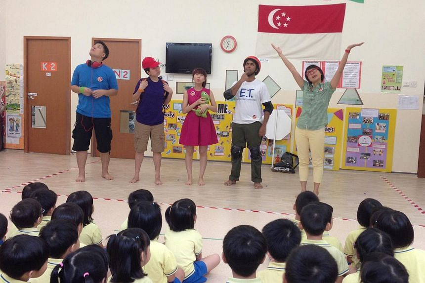 The five mascots for the upcoming children's science centre put up a performance for preschoolers in NurtureStars Child Care Centre. -- ST PHOTO: CHERYL FAITH WEE