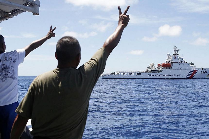 Philippine marines gesturing at a Chinese coast guard vessel in the South China Sea last month. A loss for the Philippines in challenging China's territorial claims in the South China Sea could diminish the legal grounds on which the claims of Viet