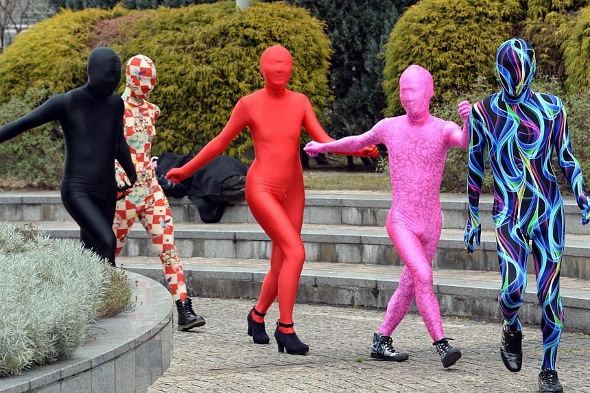 This picture taken on January 25, 2014 shows members of Tokyo Zentai Club walking on a street in Tokyo. -- PHOTO: AFP