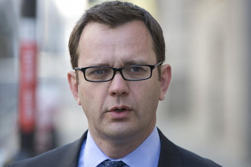Former editor of the News of the World Andy Coulson arrives at the Old Bailey courthouse in London on April 16, 2014. -- PHOTO: REUTERS