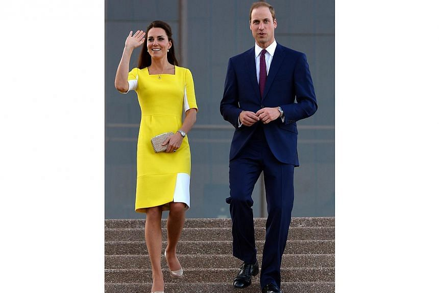 Britain's Prince William (right) and his wife Catherine, the Duchess of Cambridge, walk from the top of the stairs of Sydney's iconic landmark Opera House on April 16, 2014. -- PHOTO: AFP