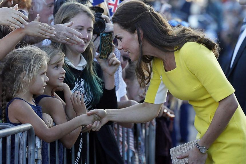 Catherine, the Duchess of Cambridge (right), greets well-wishers following a reception with Britain's Prince William (not pictured) at the Sydney Opera House on April 16, 2014. -- PHOTO: AFP