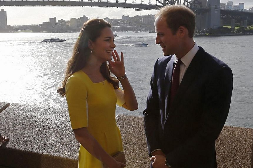 Britain's Prince William and his wife Catherine, the Duchess of Cambridge, are pictured in front of the Sydney Harbour Bridge during a reception at the Sydney Opera House on April 16, 2014. -- PHOTO: REUTERS