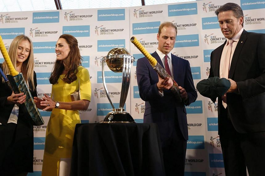 Britain's Prince William (second right) and his wife Catherine, Duchess of Cambridge (second left), receive cricket bats from Australian women's cricket team member Ellyse Perry (left) and former Australian cricket team member Glenn McGrath near the
