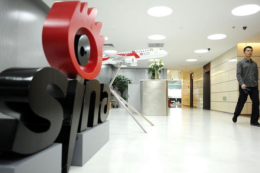A man walks past the office entrance of Sina Weibo, widely known as China's version of Twitter, in Beijing on April 16, 2014. -- PHOTO: AFP