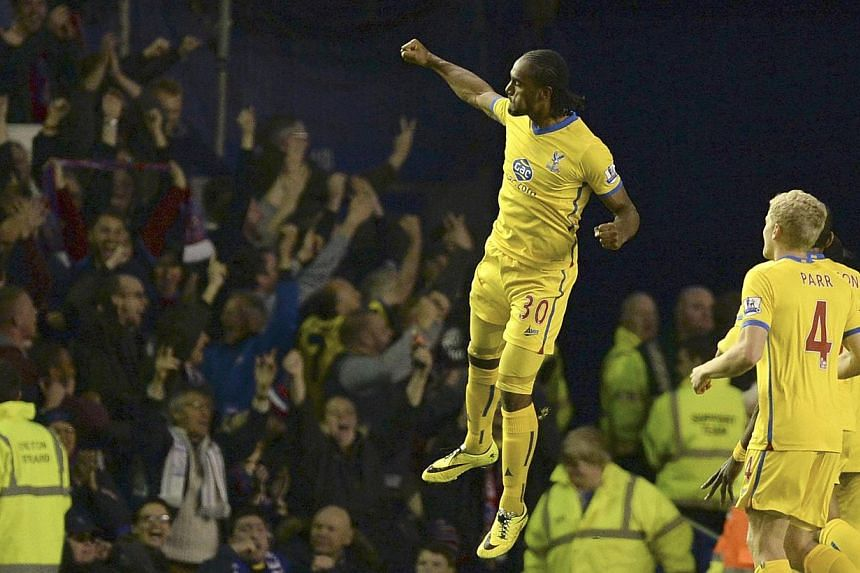 Crystal Palace's Cameron Jerome (centre) celebrates after scoring a goal against Everton during their English Premier League soccer match at Goodison Park in Liverpool, northern England on April 16, 2014. -- PHOTO: REUTERS